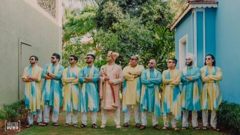 colour coordinated groomsmen with groom photo