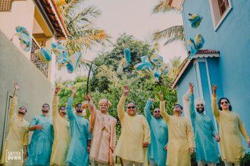 groom and groomsmen throwing safa shot