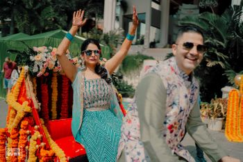 mehendi couple entry with bride entering on a rickshaw