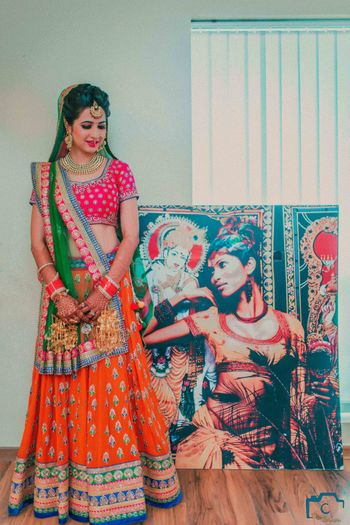 Photo of Pink and orange bridal lehenga