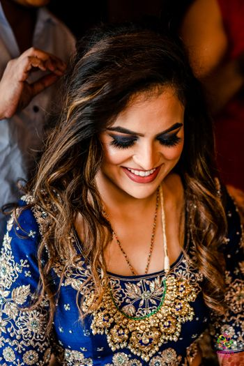 blue coloured smokey eye makeup matching the lehenga
