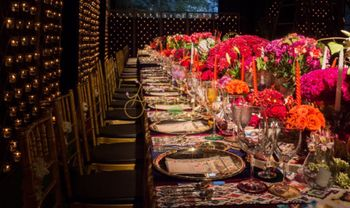 Photo of Floral table settings at reception dinner