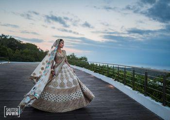 offbeat sabyasachi bridal lehenga in white and blue
