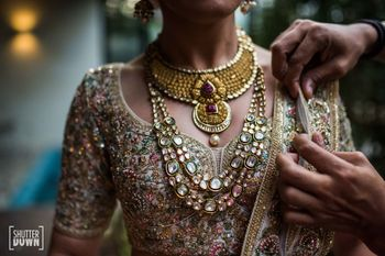 layered bridal necklace with sabyasachi lehenga