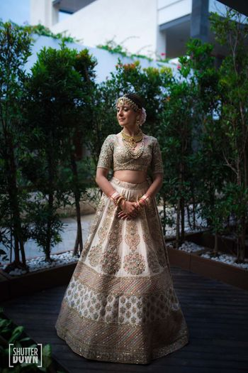 off white bridal lehenga by sabyasachi