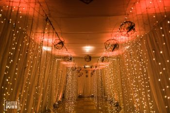 cocktail or sangeet entrance decor idea with fairy lights
