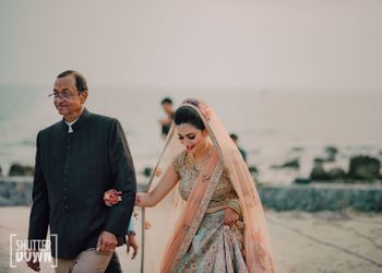 bride entering her wedding with her father