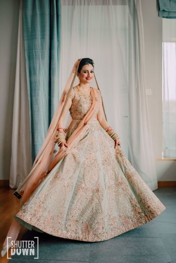 light bridal lehenga in mint and peach