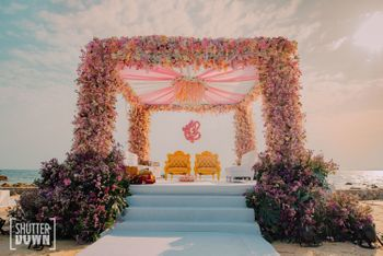 floral light pink mandap idea with ganesha prop