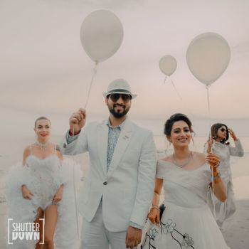 beach wedding idea with couple entry holding balloons