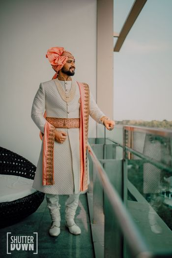 off white sherwani with peach stole and waistbelt
