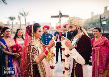 coordinated bride and groom jaimala shot in maroon