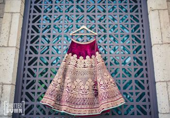 Photo of velvet bridal lehenga on hanger shot