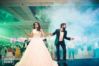 Photo of couple dancing shot on cocktail or sangeet