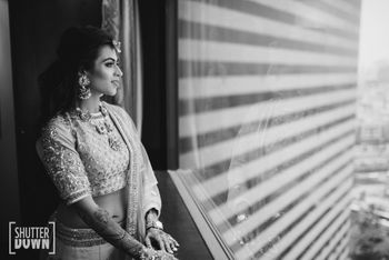 Photo of bride looking out of window shot in black and white