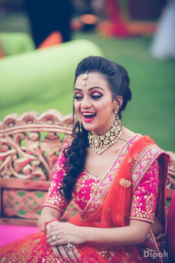Bride wearing fucschia pink and orange