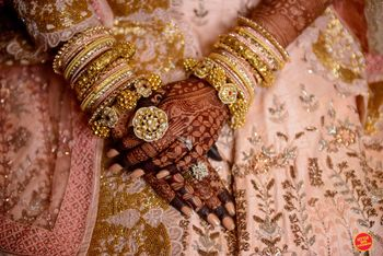 bridal hands with cocktail rings and kadas