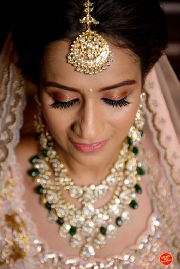 pastel bridal makeup and contrasting jewellery
