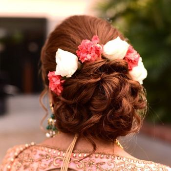 A bridal bun with flowers.