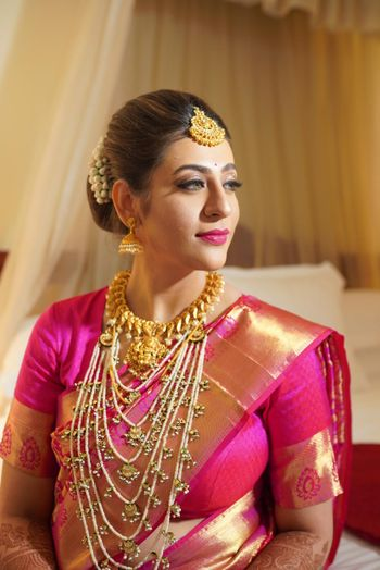A south Indian bride in a pink kanjeevaram and gold temple jewellery