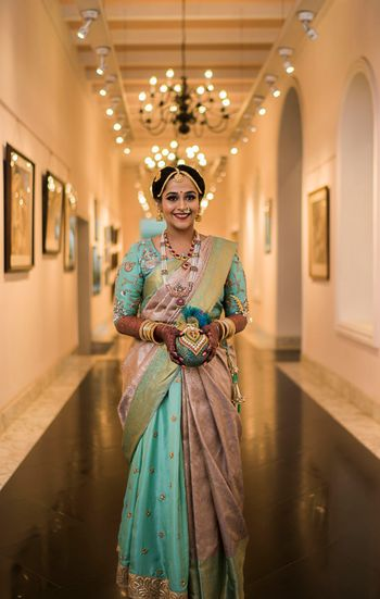 A south Indian bride in a unique hued kanjeevaram for her wedding