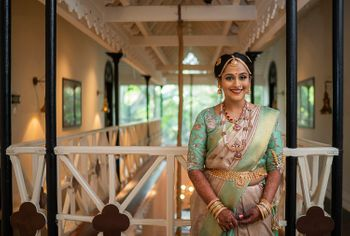 A south Indian bride in a unique hued Kanjeevaram