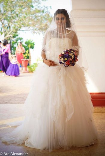 White Frill Christian Wedding Gown with Floral Bouquet