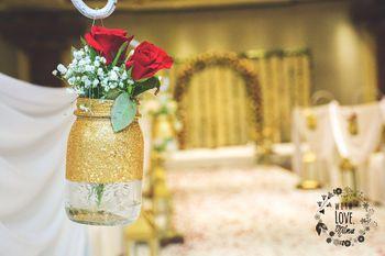 Photo of Gold Mason Jars Decor with Roses