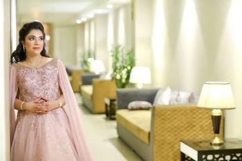 cocktail gown in light pink with cape sleeves