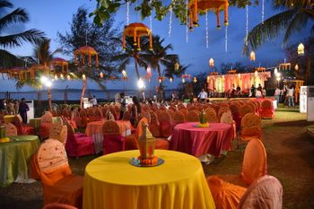 Photo of Yellow Table Decor with Colorful Lanterns
