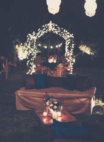 Photo of Fairy Lights Decor with Floral Centerpieces and Candles