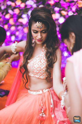 Bride applying mehendi