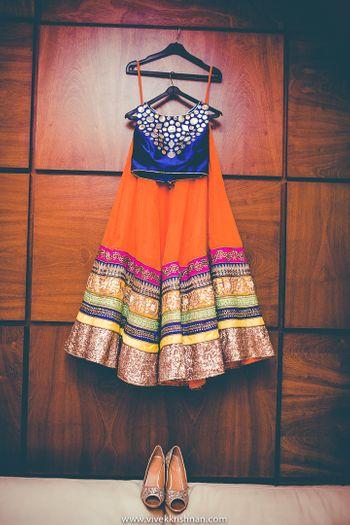 Royal Blue and Orange Lehenga on a Hanger