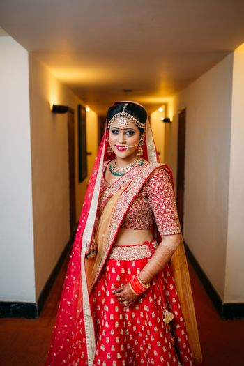 Photo of Red and Gold Lehenga with Gold Jewelry