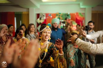 A happy dancing bride in floral jewellery