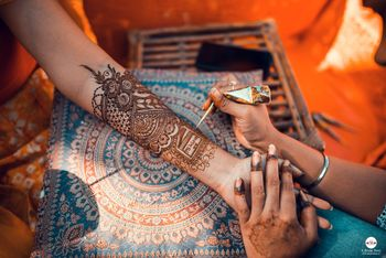 A mehndi design with a personalized text.
