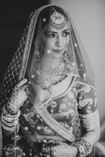 black and white bridal photo in sabya lehenga