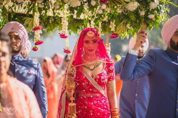 Bride entering with brothers under phoolon ki chadar.