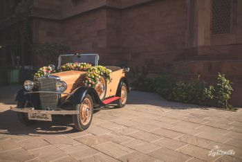 A vintage car decorated with flowers.
