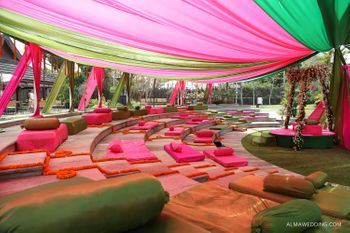 Photo of Pink and Green Canopy Tents with Pink Seating