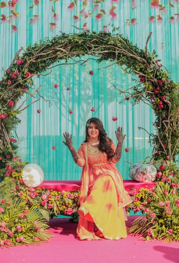 rustic mehendi seating for bride with an arch