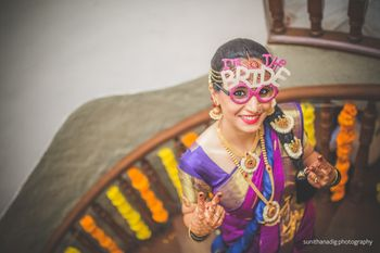 south indian bride wearing prop glasses