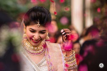 happy bride shot during day wedding in pink