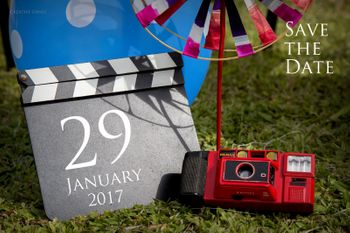 Save the date card with camera and clapboard