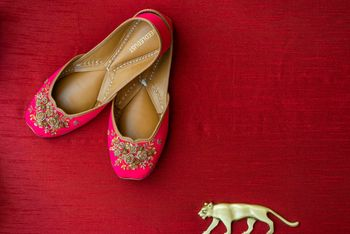 bridal juttis in bright pink with floral embroidery