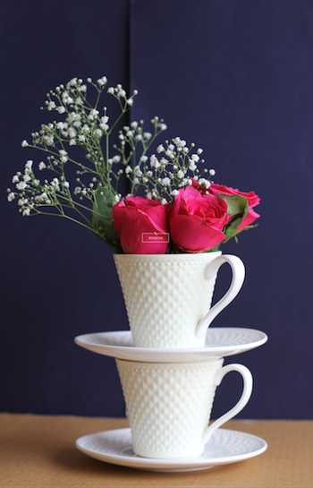 Double Tea Cups with Flowers Centerpiece