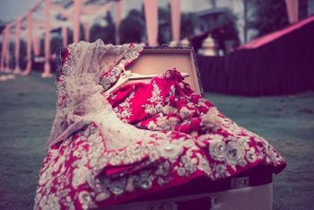 Red bridal lehenga inside trunk