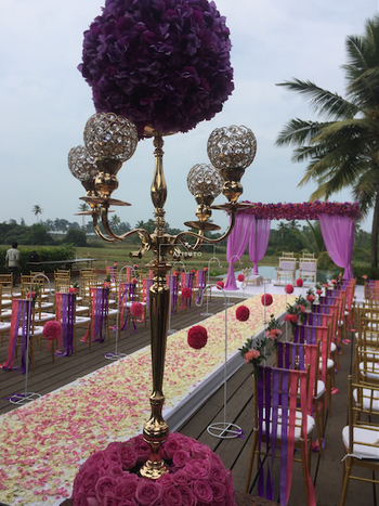 Gold Candelabras with Purple and Pink Decor