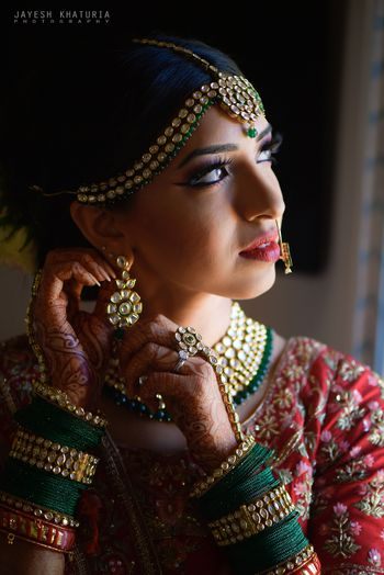 green bridal jewellery and bangles