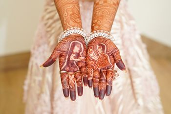 Photo of Mehndi design with a guy proposing to a girl.